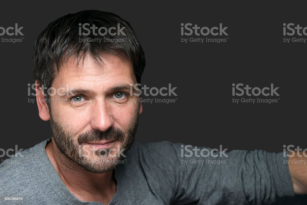 charming attractive man portrait isolated on gray stock photo