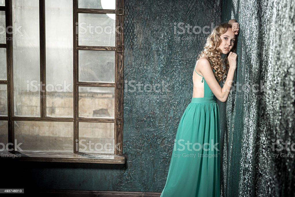 Charming Blonde In Backless Dress stock photo