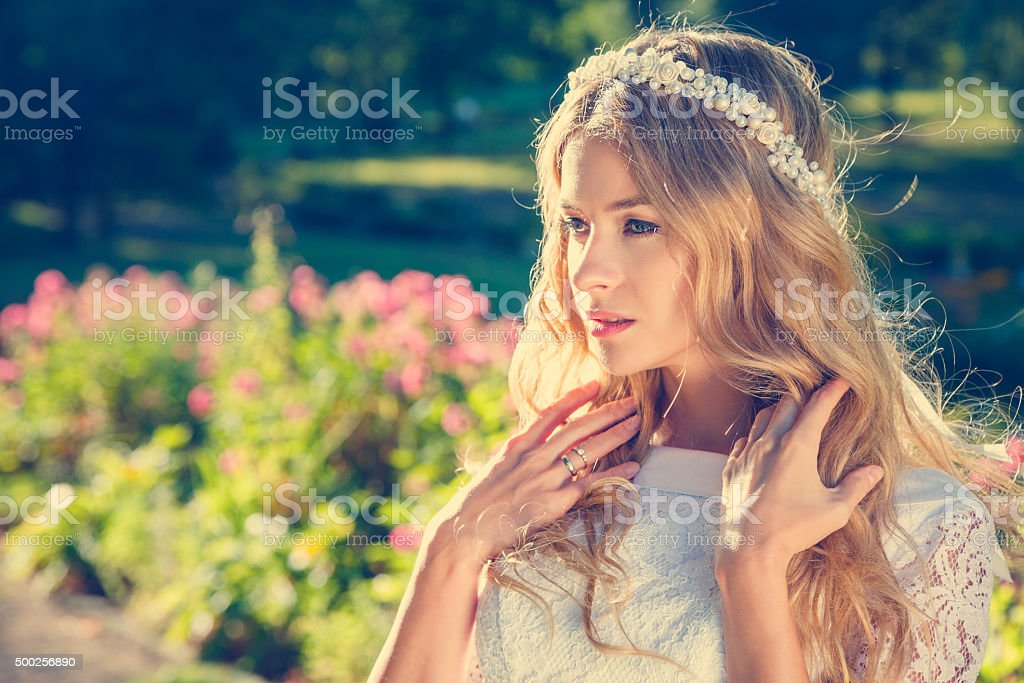 Charming Bride on Nature Background stock photo