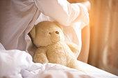 Charming Brunette Sitting On Bed