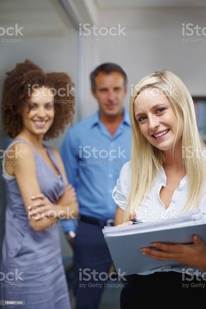 Charming businesswoman holding a folder royalty-free stock photo