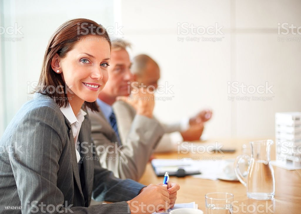 Charming businesswoman in a meeting with her colleagues royalty-free stock photo