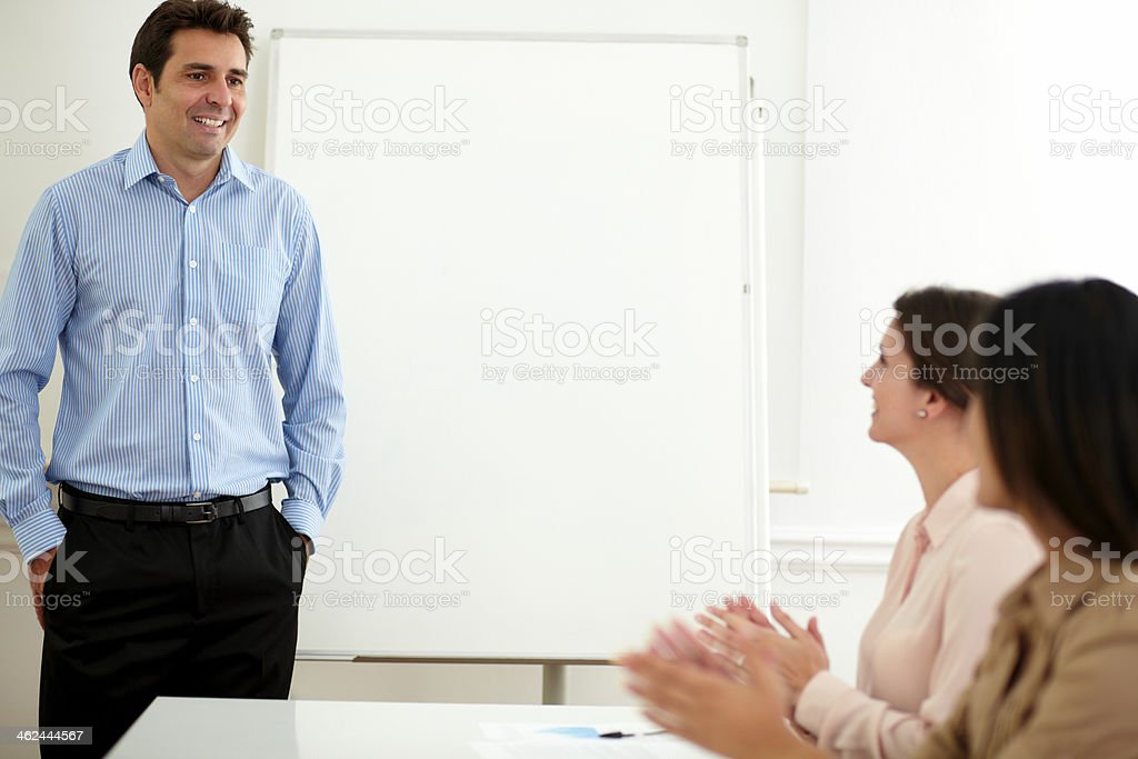 Charming businesswomen smiling and giving applause stock photo
