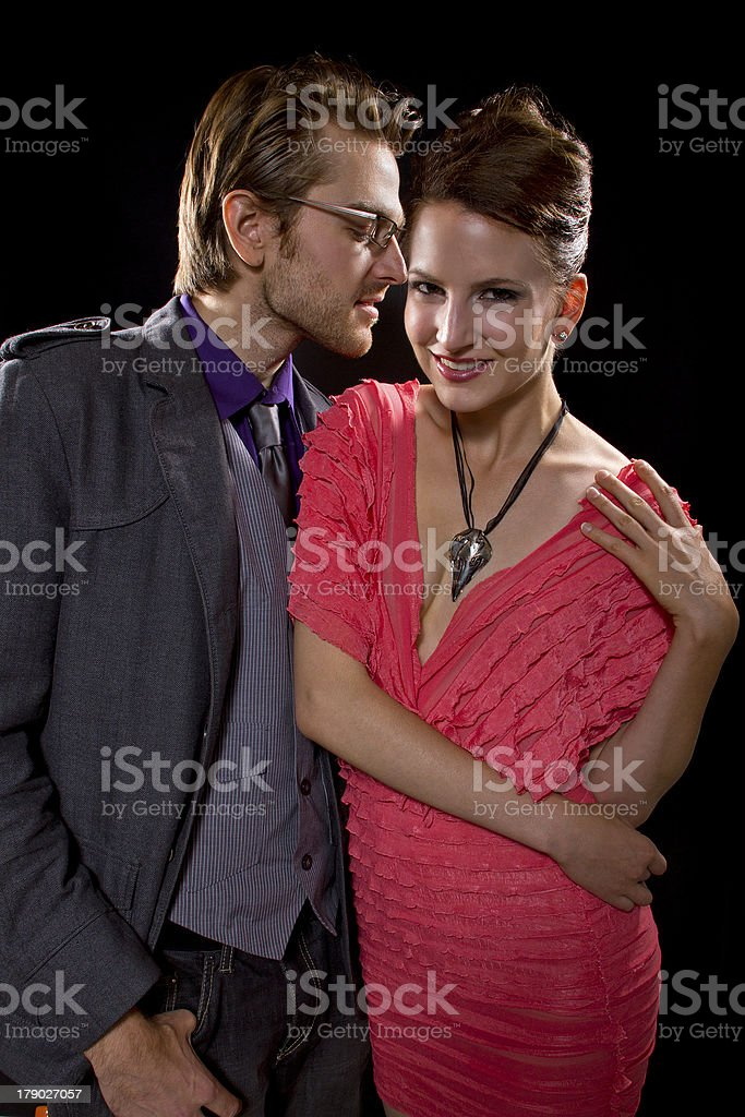 Charming Dating Couple Whispering Romantic Secrets To Each Other royalty-free stock photo