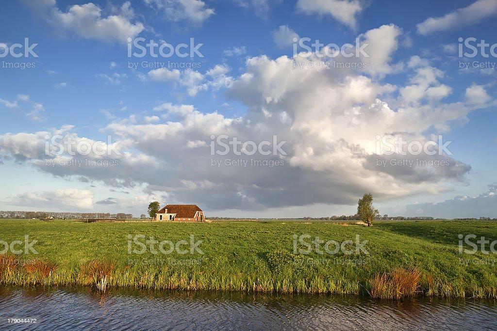 charming farmhouse and beautiful sky royalty-free stock photo