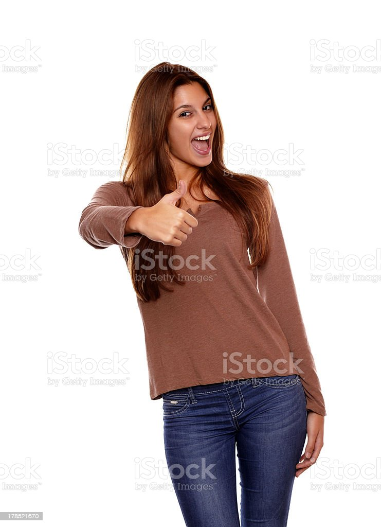 Charming female smiling and showing you ok sign royalty-free stock photo