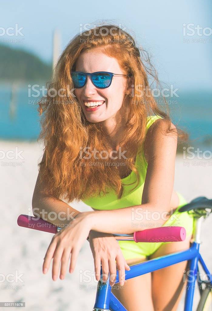 charming female with rental bike outdoors stock photo