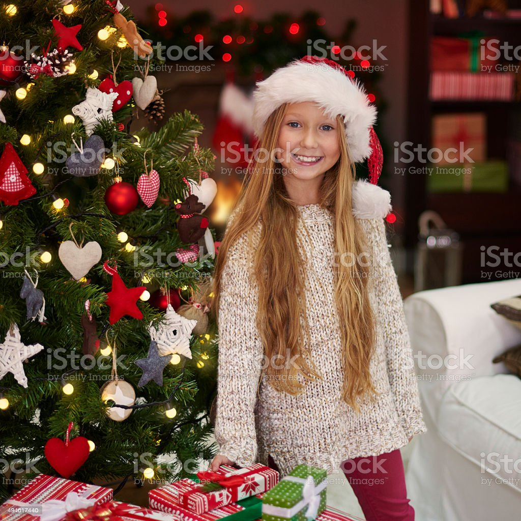 Charming girl next to the Chistmas tree stock photo