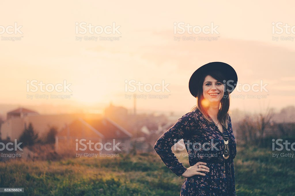 Charming girl sunbathed by rays of the Sun stock photo