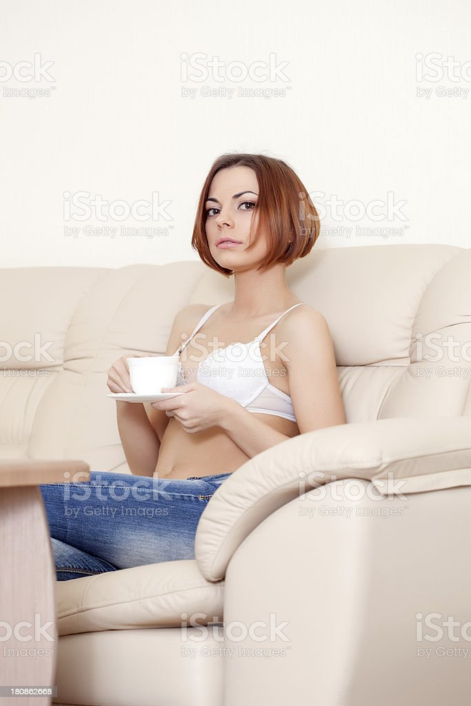 Charming girl with short hair drinks tea, close-up royalty-free stock photo