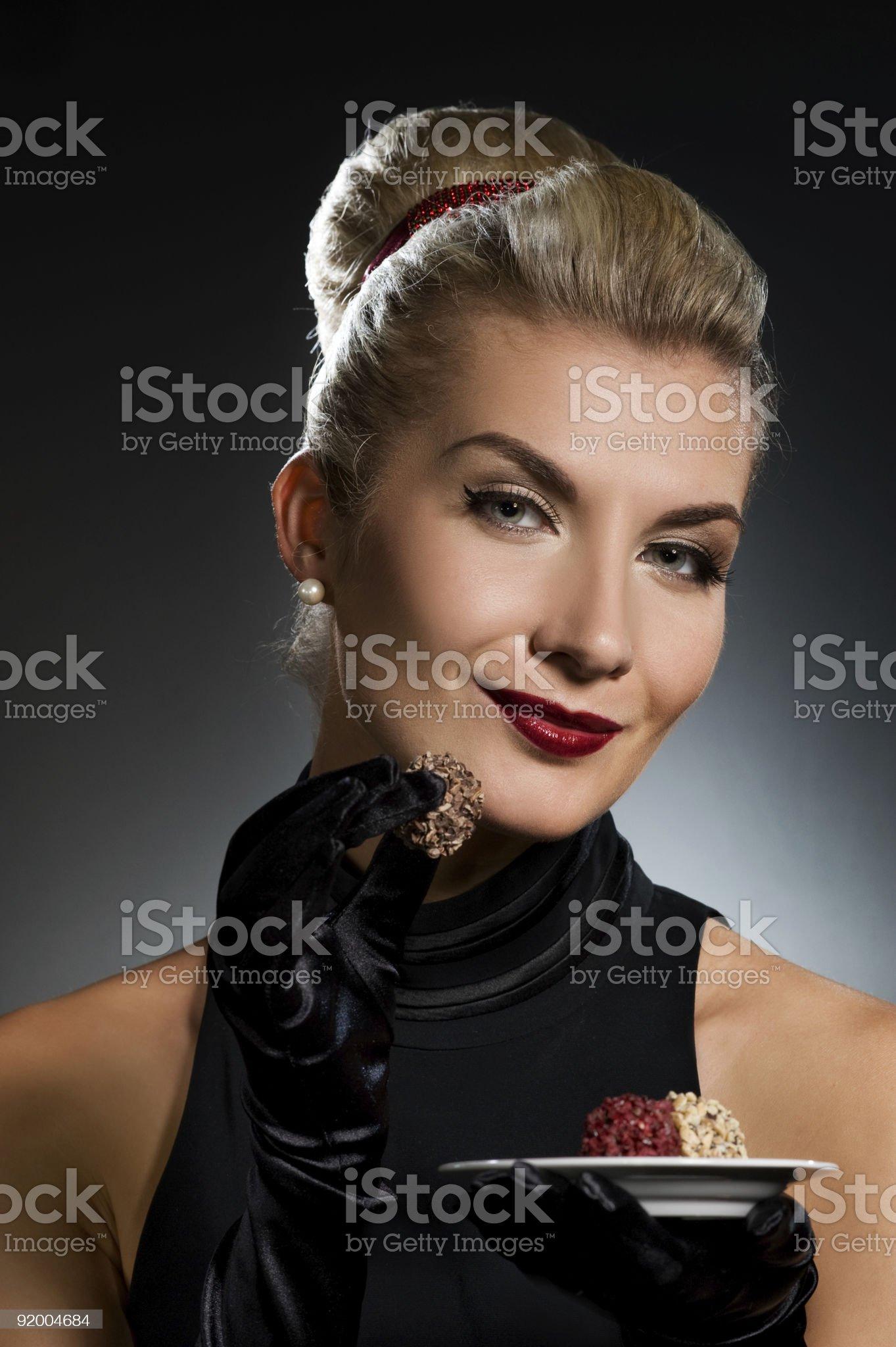 Charming lady tasting chocolate royalty-free stock photo