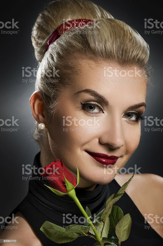 Charming lady with red rose royalty-free stock photo