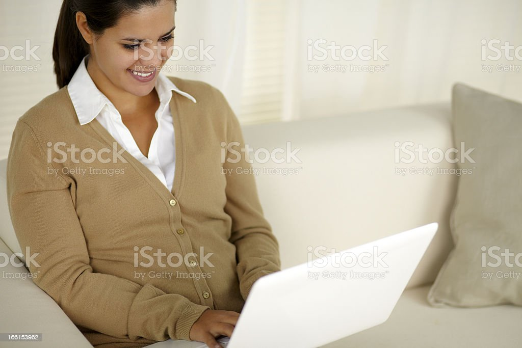 Charming latin young woman using her laptop royalty-free stock photo