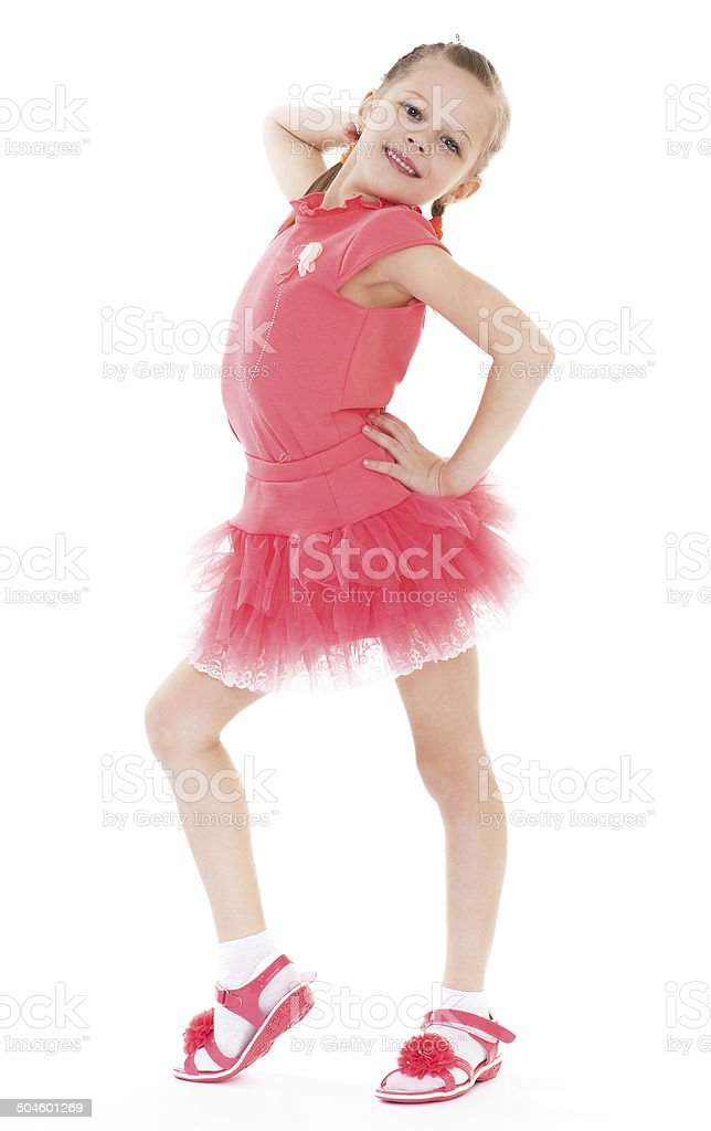 Adorable petite fille en robe courte. photo libre de droits