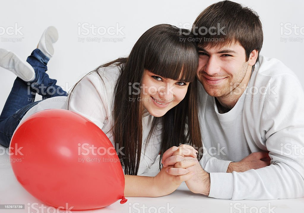 Charming love couple lying on the floor royalty-free stock photo