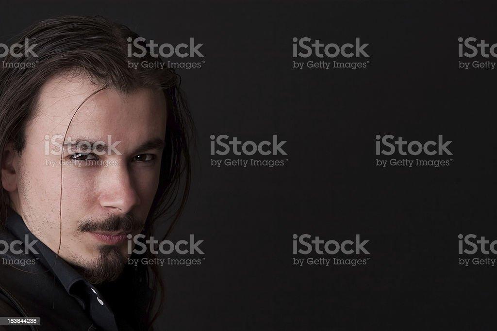 charming man posing on black background stock photo