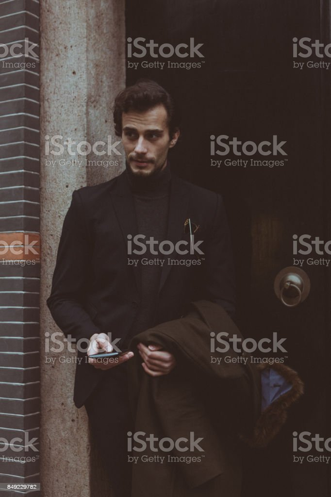 Charming man texting on mobile stock photo