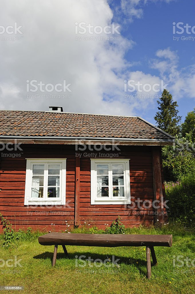 Charming old cottage with a bench stock photo