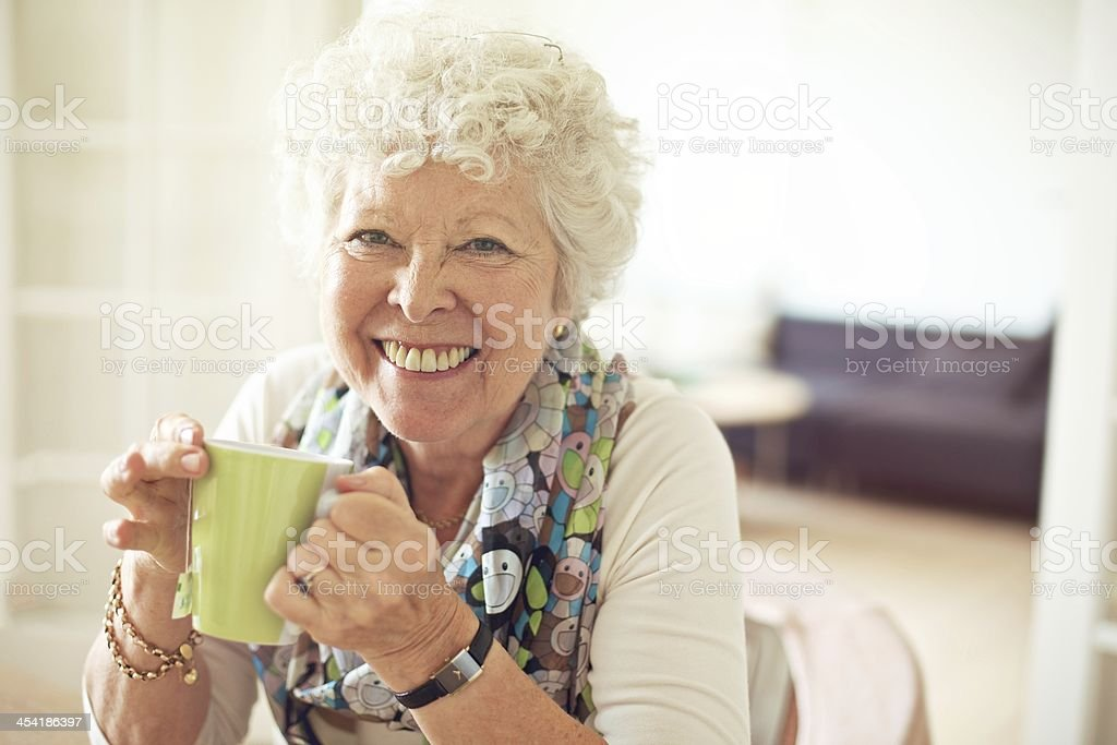 Charming Old Lady with a Cup of Tea stock photo