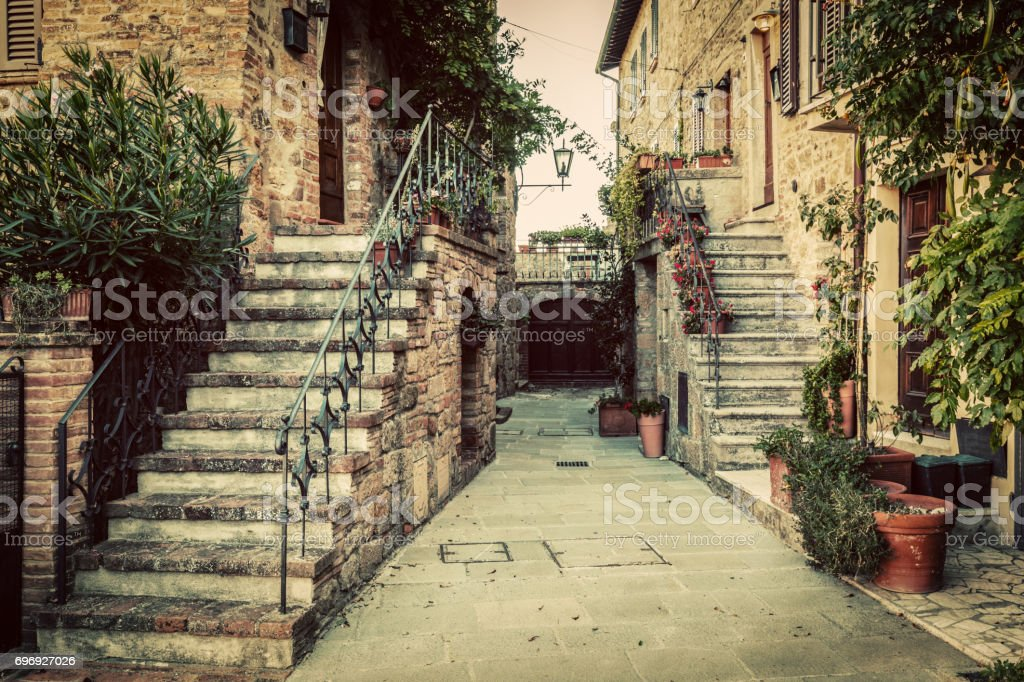 Charming old medieval architecture in a town in Tuscany, Italy. stock photo