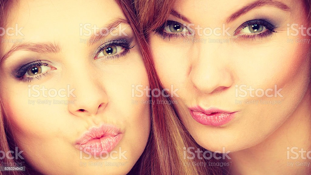 Charming positive female siblings. stock photo