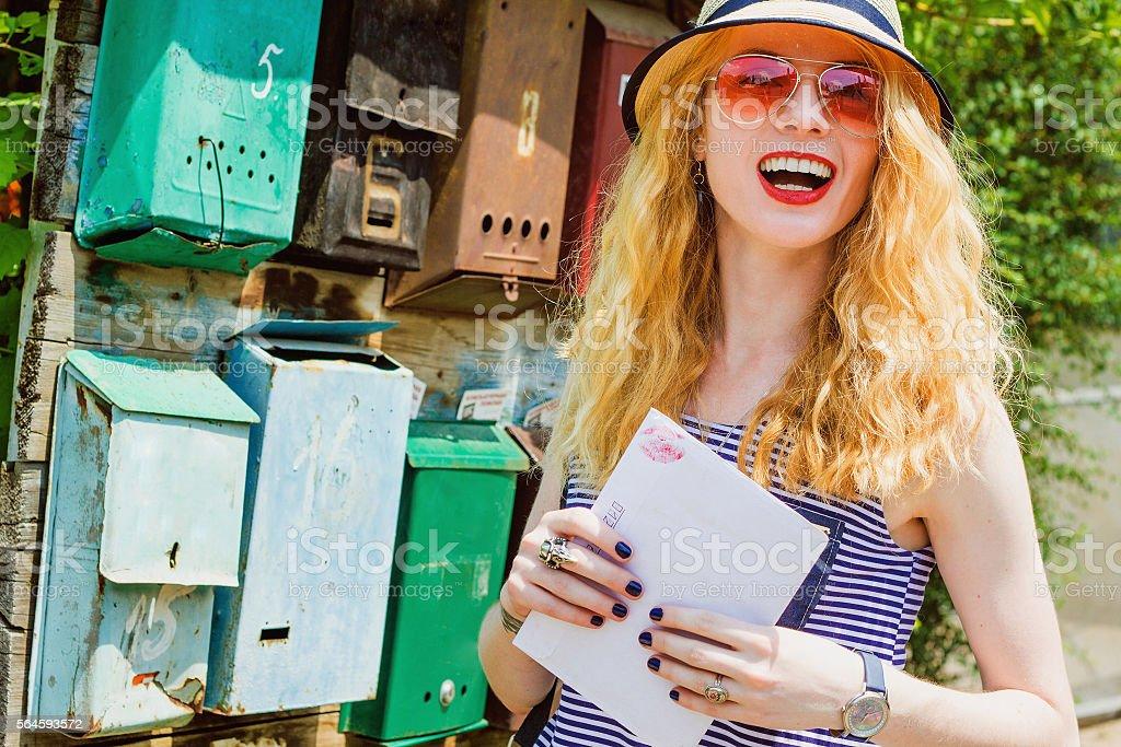 Charming postman stock photo