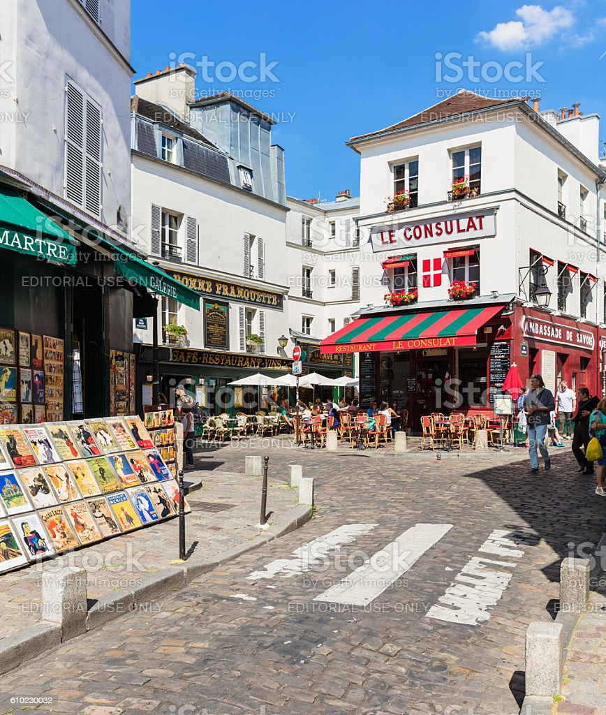 Charming quarter of Montmartre with traditional french cafes, Paris, France royalty-free stock photo