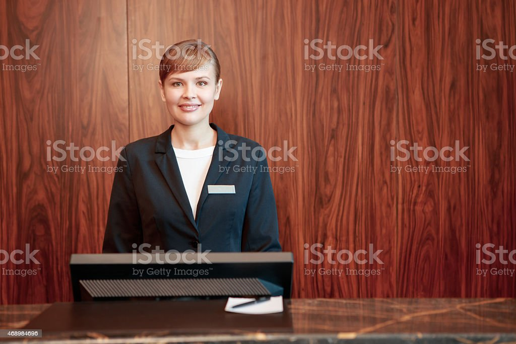 Charming receptionist at work stock photo