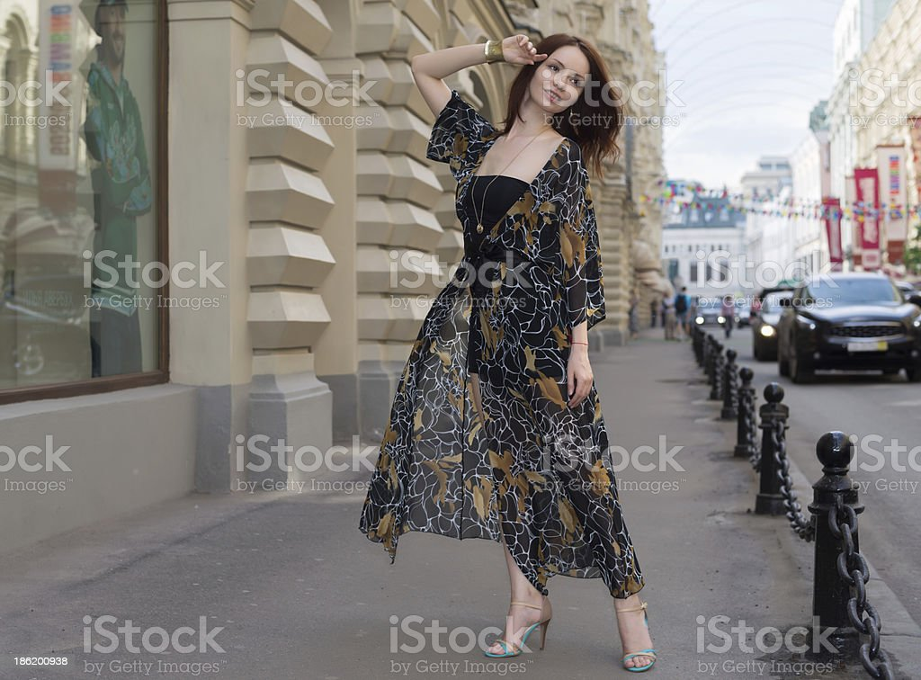 Charming sensual woman in fashionable gauzy clothing on a street royalty-free stock photo