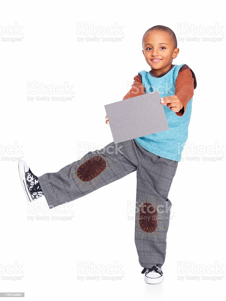 Charming small boy holding a billboard royalty-free stock photo