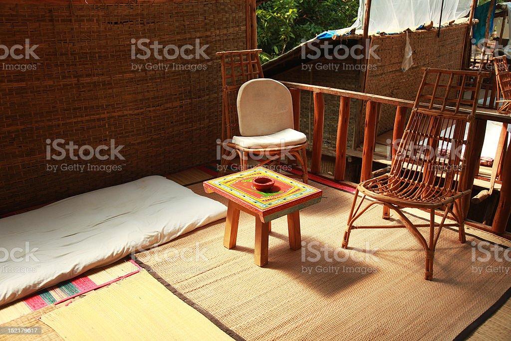 Charming Straw Hut Patio royalty-free stock photo