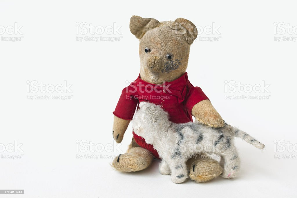Charming vintage worn teddy bear and toy cat. royalty-free stock photo