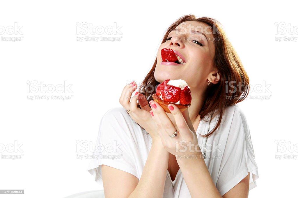 Charming woman eating fresh strawberry cake royalty-free stock photo
