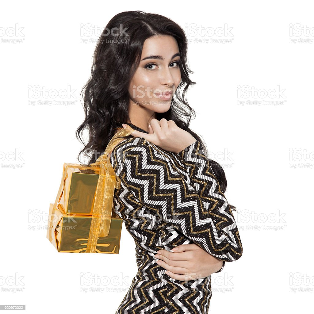 Charming Woman Holding Gifts. Happy New Year. Merry Christmas. stock photo