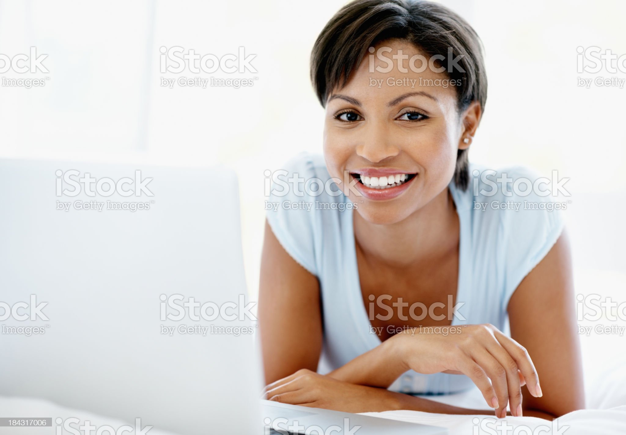 Charming woman surfing the internet on laptop royalty-free stock photo
