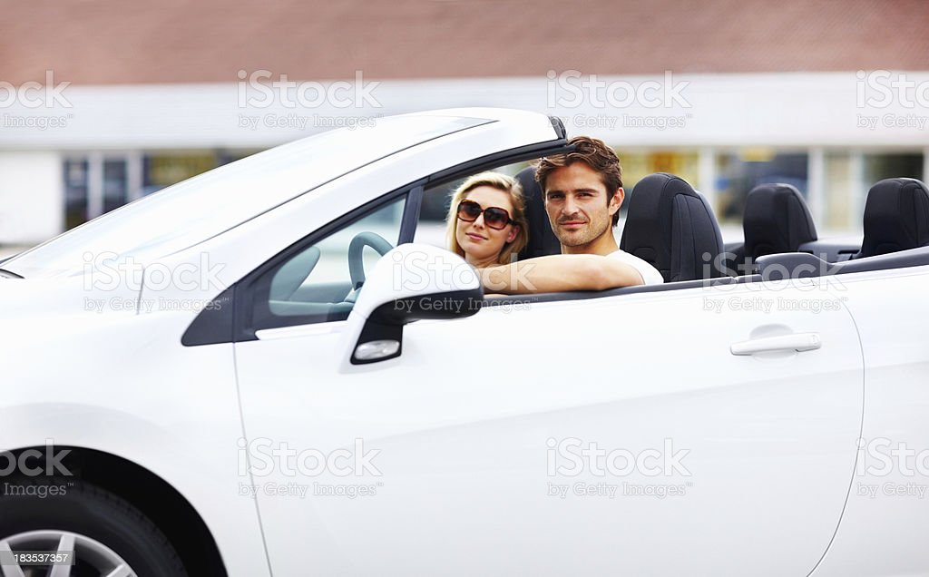 Charming, young couple in a convertible royalty-free stock photo