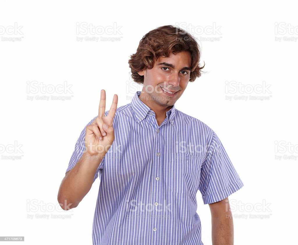 Charming young man showing you victory sign royalty-free stock photo