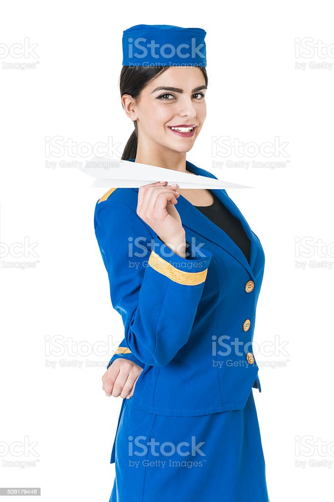 Charming Young Stewardess Holding Paper Plane In Hand stock photo