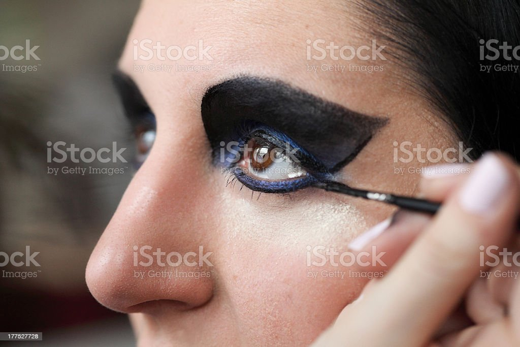 Charming young woman applying blusher eyelid royalty-free stock photo