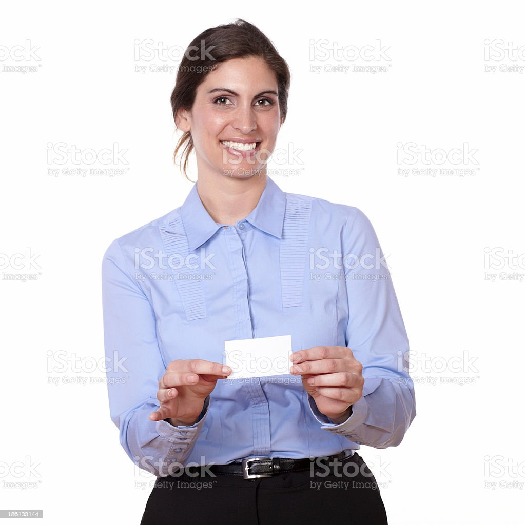 Charming young woman smiling holding a blank card royalty-free stock photo