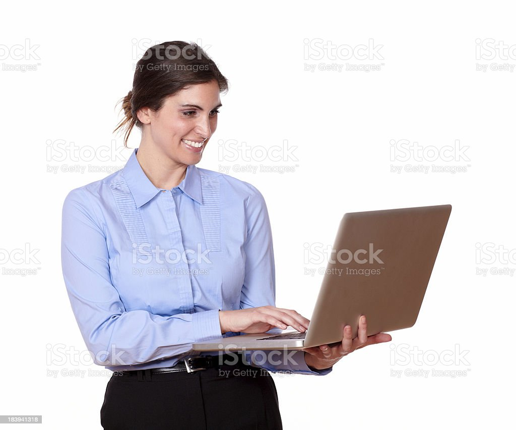Charming young woman working on a laptop royalty-free stock photo