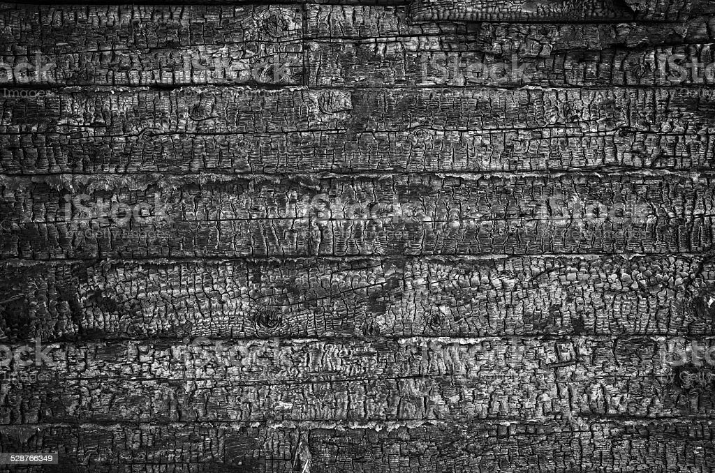 Charred wall of planks texture stock photo