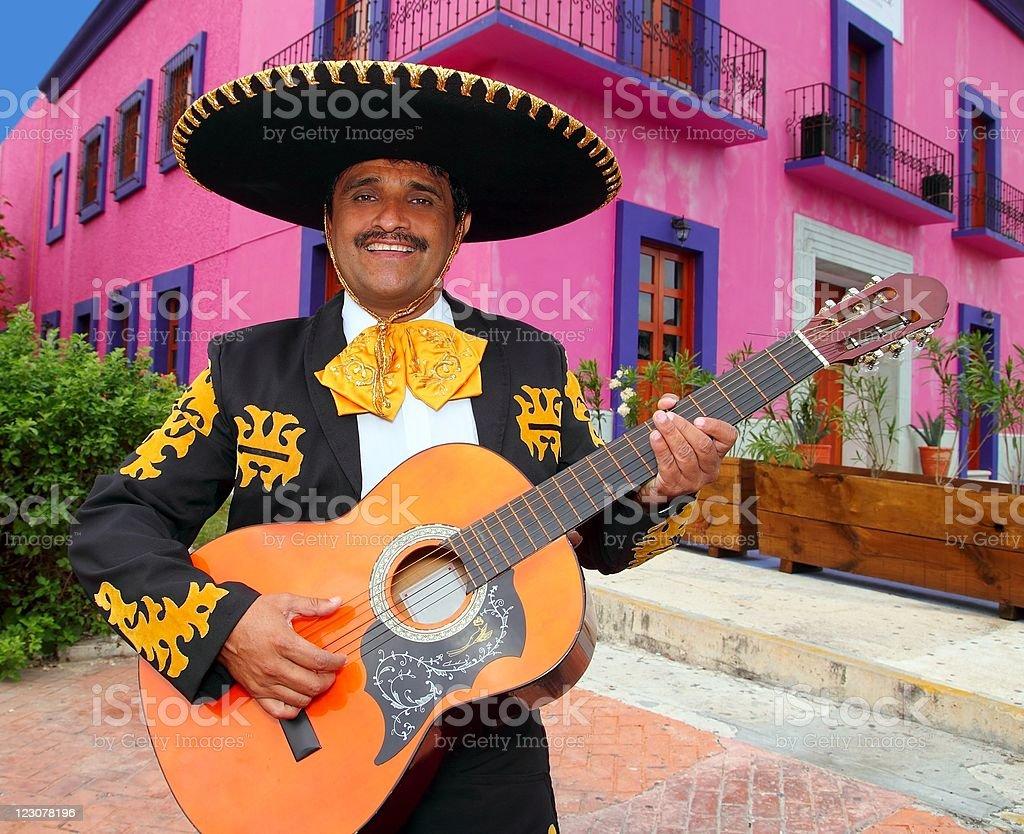 Charro Mariachi playing guitar Mexico houses stock photo