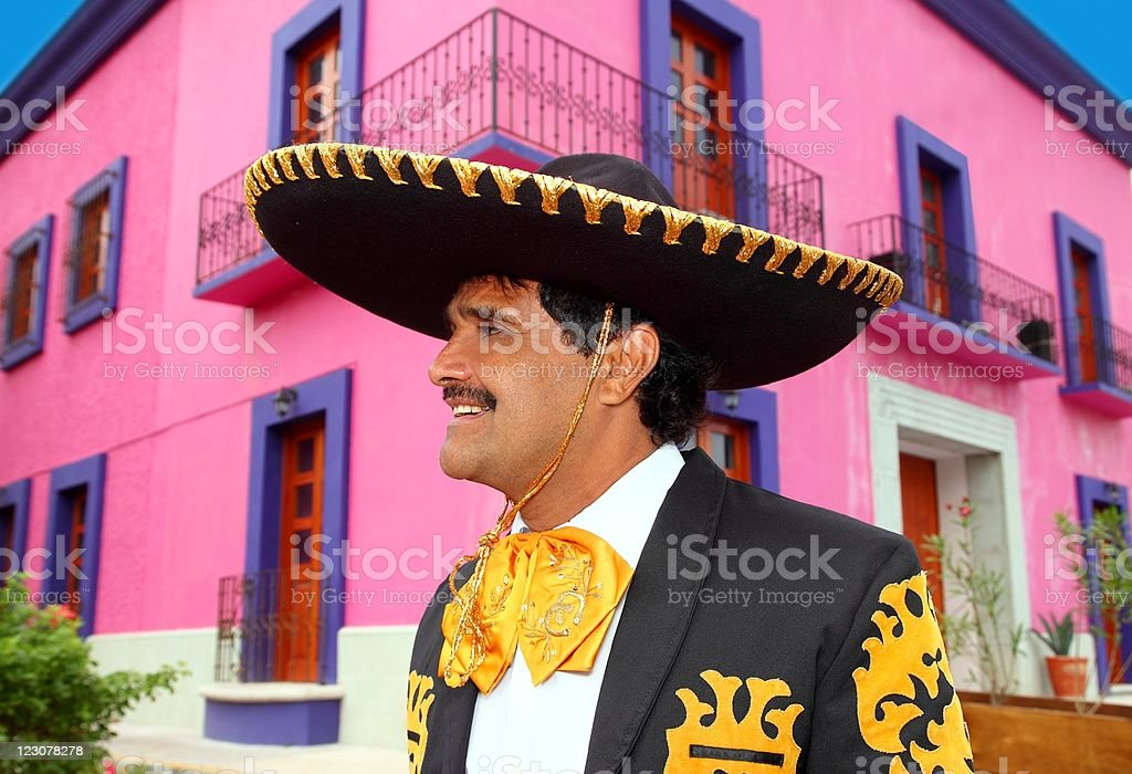 Charro mexican Mariachi portrait in pink house royalty-free stock photo