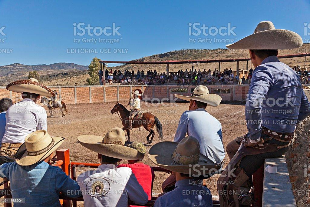 Charros watching a Charro show stock photo