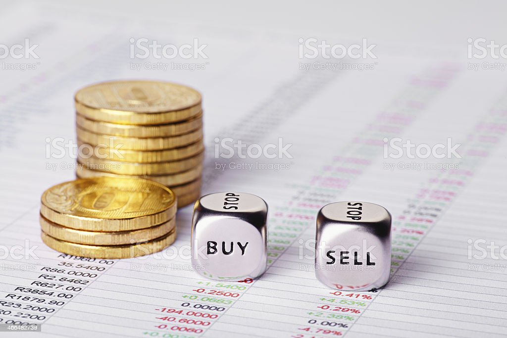 Chart, coins and dices cubes with words Sell Buy. stock photo