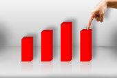 Chart concept, Businessman pressing down to make bar charts.