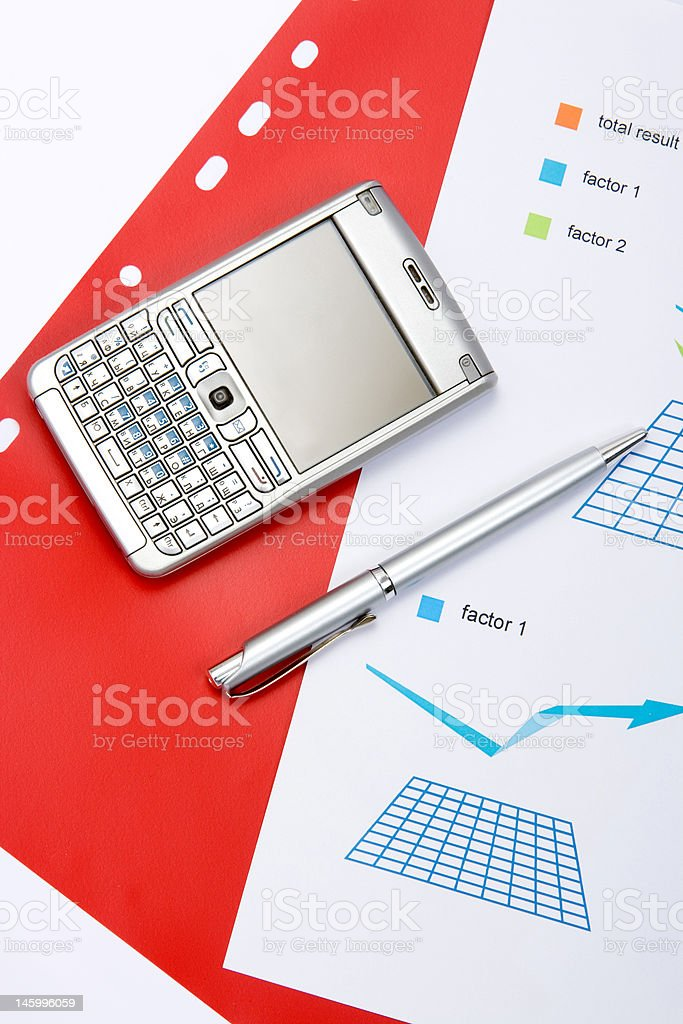 chart with a pen and mobile royalty-free stock photo