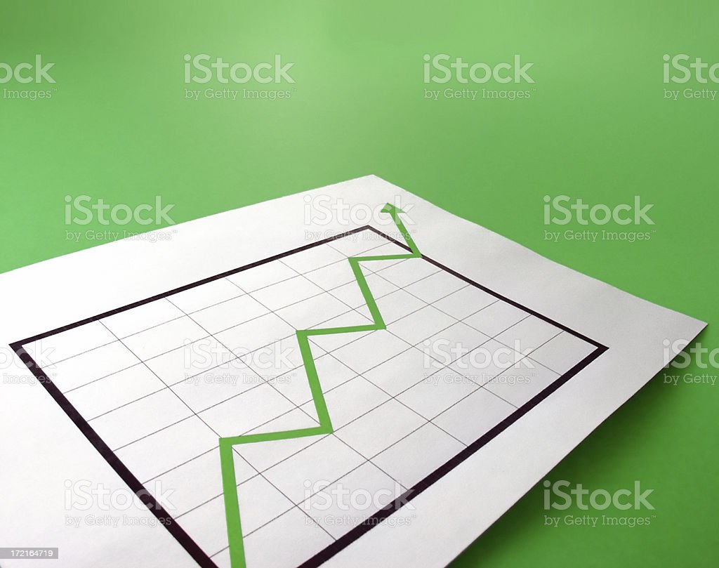Chart with green arrow indicating positive figures royalty-free stock photo