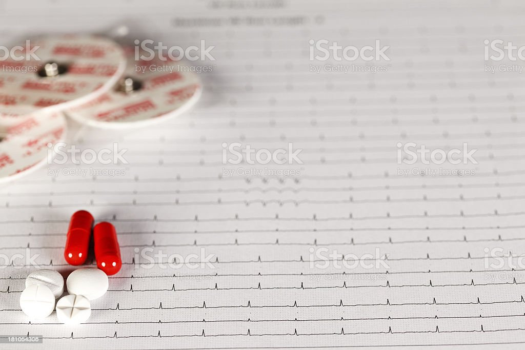 EKG chart with pills on it royalty-free stock photo